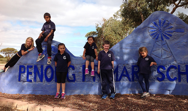 children standing at the penong sign