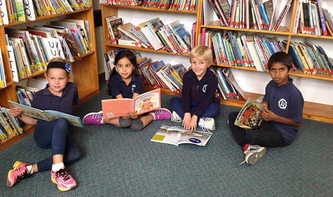 children sitting in the library